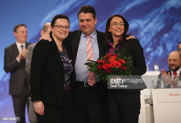 Sigmar Gabriel German Vice Chancellor and Chairman of the German Social Democrats poses with outgoing SPD General Secretary Andrea Nahles and...
