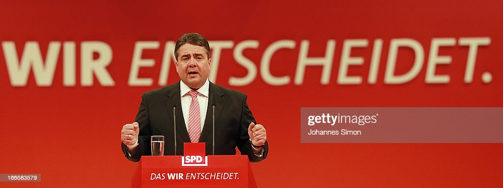 <a gi-track='captionPersonalityLinkClicked' href=/galleries/search?phrase=Sigmar+Gabriel&family=editorial&specificpeople=543927 ng-click='$event.stopPropagation()'>Sigmar Gabriel</a>, head of the German Social Democrats (SPD), speaks at the SPD federal party congress on April 14, 2013 in Augsburg, Germany. Peer Steinbrueck, SPD chancellor candidate will face Chancellor and Christian Democrat (CDU) Angela Merkel in federal elections scheduled for September. So far Steinbrueck's ratings in the polls have lagged far behind those of Merkel following several comments and gaffes on Steinbrueck's part.