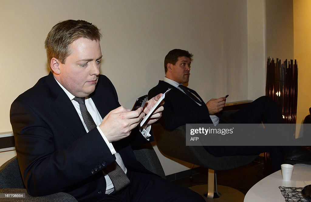 Sigmundur Gunnlaugsson, leader of Iceland's Progressive Party (L) and Bjarni Benediktsson (R) , leader of the Independence Party check their mobile devices as they wait for a TV debate at the state's TV station on election night in Reykjavík, Iceland on April 28, 2013. Iceland's centre-right opposition scored a clear victory in the island's parliamentary poll, allowing the two parties to kick off negotiations for a coalition government, a final count Sunday, April 28, 2013 showed.