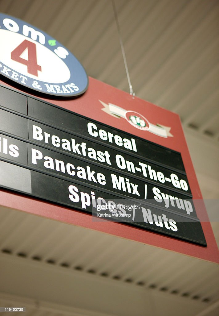 Sign above grocery store aisle.