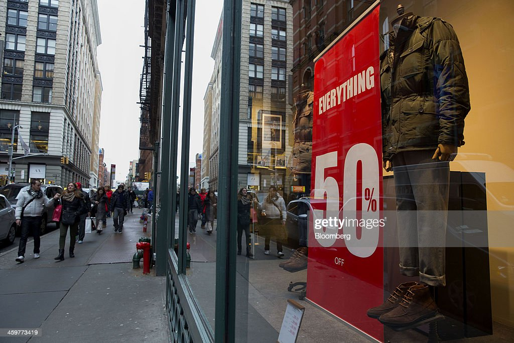 A sign advertises 50% off everything at a store in the Soho neighborhood of New York, U.S., on Monday, Dec. 30, 2013. The failure of United Parcel Service Inc. (UPS) and FedEx Corp. to deliver packages in time for Christmas has exposed the perils of retailers promising to get last-minute gifts to customers. Photographer: Jin Lee/Bloomberg via Getty Images