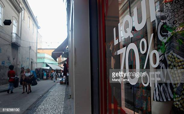 A sign advertises 70 percent discounts in the Saara discount shopping district on April 5 2016 in Rio de Janeiro Brazil Brazil is in the midst of...