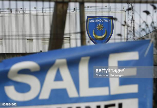 A sign advertises a car boot sale at Portsmouth FC's Fratton Park ground is pictured near a domestic property's For Sale sign in Frogmore Road after...