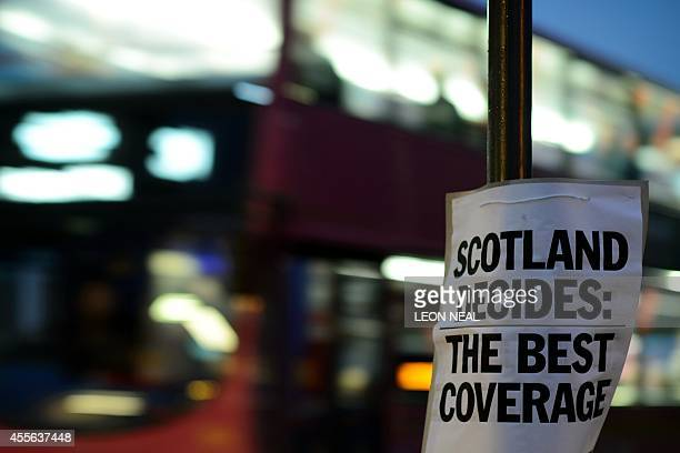 A sign advertises a local newspaper as polling stations open their doors in Edinburgh Scotland on September 18 during a referendum on Scotland's...