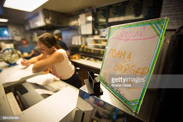 A sign advertises an Obama Burger at John's Fish Market in Vineyard Haven Mass on the island of Martha's Vineyard Aug 18 2016 President Barack Obama...