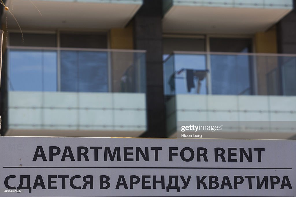 A sign advertises apartments for rent in English and Russian languages in Limassol, Cyprus, on Tuesday, April 8, 2014. Cyprus wants to shield financial flows with Russia, where it's the biggest foreign investor, as the U.S. and the European Union ratchet up sanctions in response to President Vladimir Putin's annexing Crimea from Ukraine. Photographer: Andrew Caballero-Reynolds/Bloomberg via Getty Images
