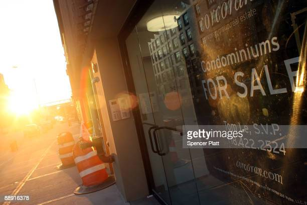 A sign advertises condos an empty new apartment building July 8 2009 in the Brooklyn neighborhood of Williamsburg in New York City Due to the fall in...