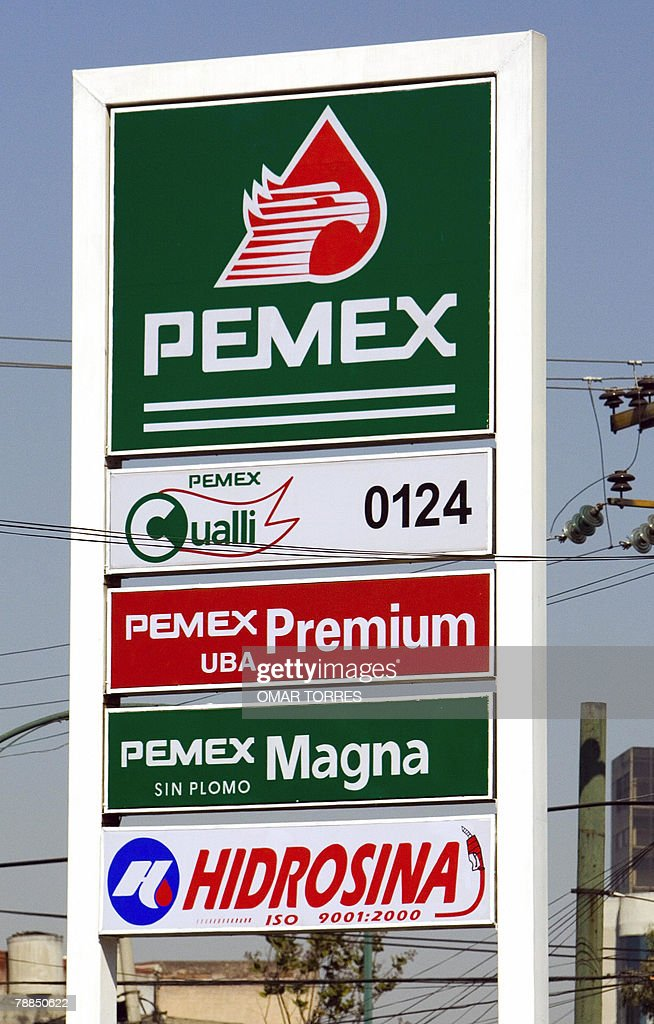 A sign advertises different kinds of gasoline at a Pemex gasoline station in Mexico City 09 January 2008 The increase in the prices of basic products...