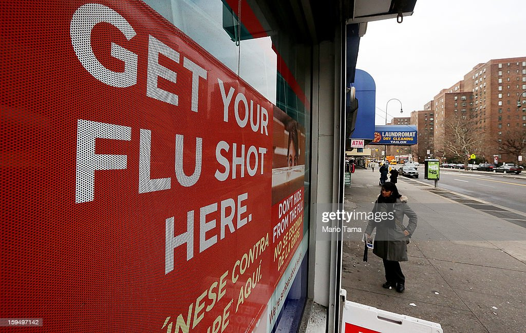 A sign advertises flu shots at a Manhattan pharmacy on January 14, 2013 in New York City. The state of New York has declared a public health emergency in a flu epidemic of more than 19,000 confirmed cases in the state.