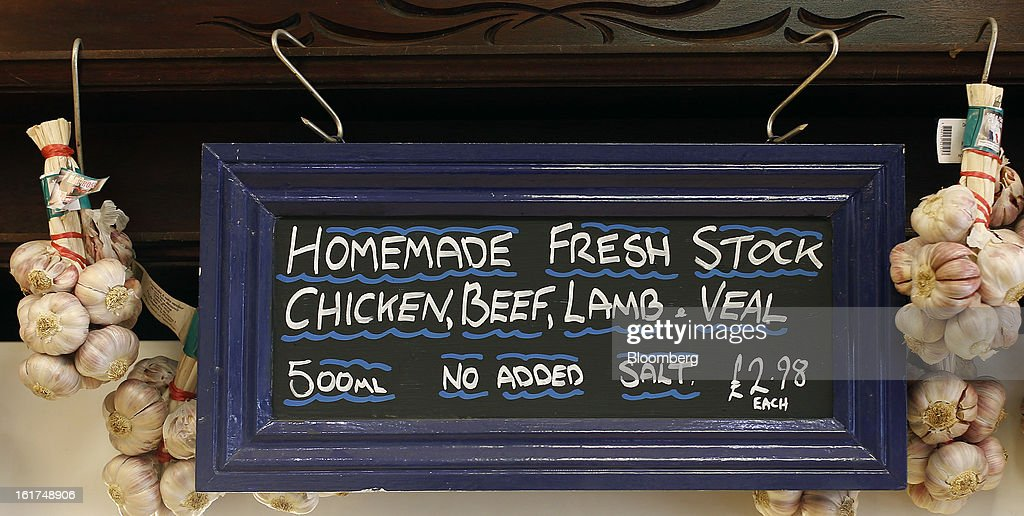 A sign advertises fresh meat stock above a counter at M.Moen & Sons butcher's shop in the Clapham district of London, U.K., on Friday, Feb. 15, 2013. While there's no evidence yet that consumer beef demand has slowed in the U.K., customers probably will spend more on higher quality cuts at meat counters or buy from independent butchers, Nick Allen, the executive director of the Agriculture & Horticulture Development Board's beef and lamb unit, known as Eblex, said. Photographer: Simon Dawson/Bloomberg via Getty Images