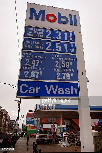 A sign advertises gas prices at a Mobil station April 30 2009 in Chicago Illinois Exxon Mobil Corp today reported its lowest profit in five years for...