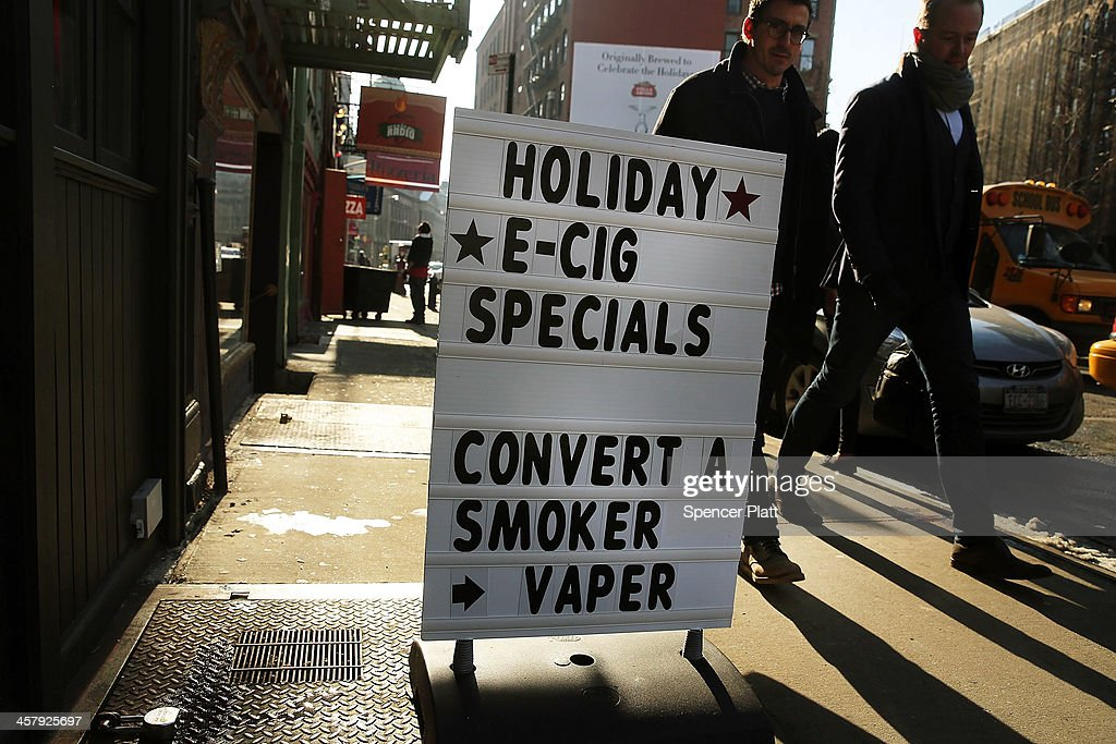 A sign advertises outside of the newly opened Henley Vaporium on December 19, 2013 in New York City. The New York City Council on Thursday will vote on a bill that would add electronic cigarettes to the city's strict smoking ban. If the Mayor Bloomberg backed ban is approved, the city would give businesses and restaurants a year to put up signs indicating there is no smoking or vaping allowed. The Henley Vaporium features a smoking bar and a coffee bar where tea and snacks are served in a relaxed environment.