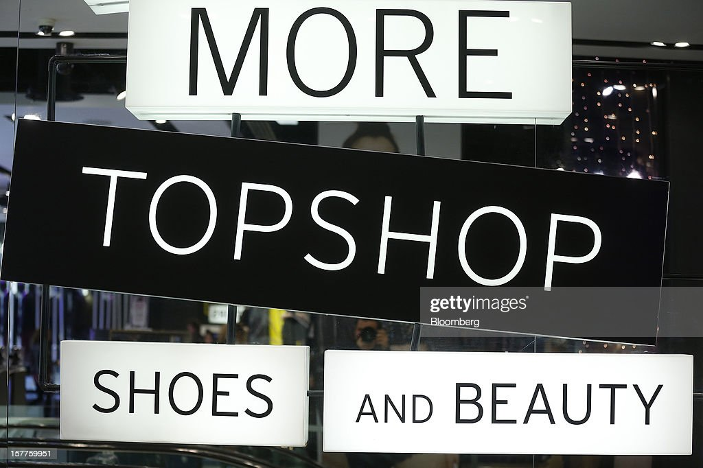 A sign advertises shoes and beauty departments inside a Topshop store, owned by Arcadia Group Ltd., on Oxford Street in London, U.K., on Thursday, Dec. 6, 2012. Philip Green, the billionaire owner of the Arcadia fashion business, sold a 25 percent stake in the Topshop and Topman retail chains to Leonard Green & Partners LP, the co-owner of the J Crew fashion brand, in a deal valuing the businesses at 2 billion pounds ($3.2 billion). Photographer: Simon Dawson/Bloomberg via Getty Images