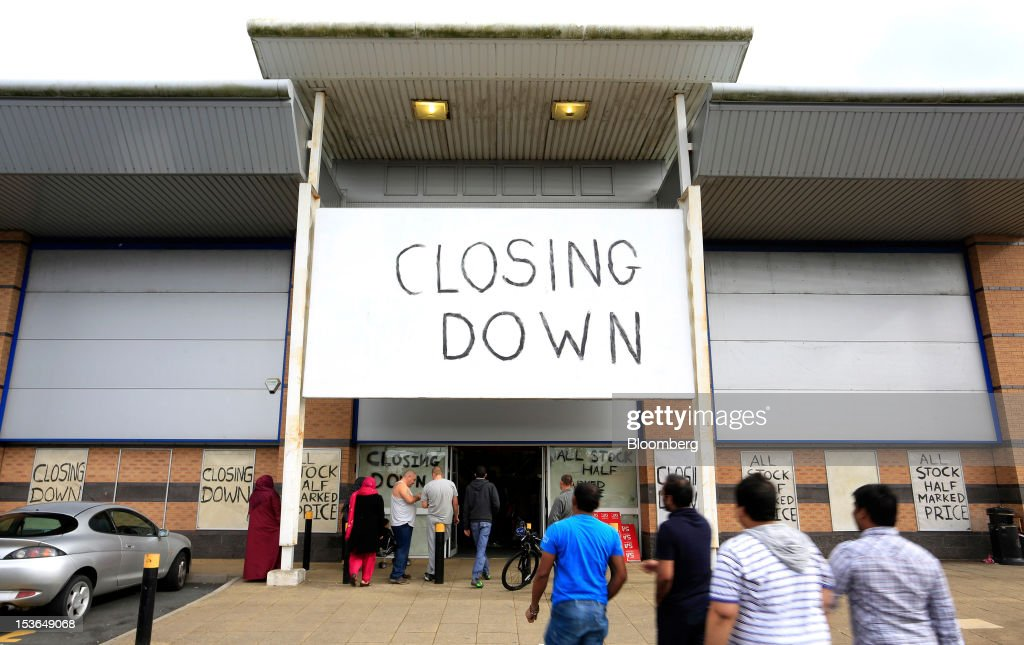 A sign advertising a closing down sale is displayed outside a JJB Sports Plc store in Rochdale, U.K., on Saturday, Oct. 6, 2012. JJB Sports Plc, a U.K. sporting goods retailer, will close most of its stores with the remaining 20 being acquired by competitor Sports Direct International Plc, according to a statement from KPMG LLP, which was appointed as administrator to the Wigan, England-based company. Photographer: Paul Thomas/Bloomberg via Getty Images