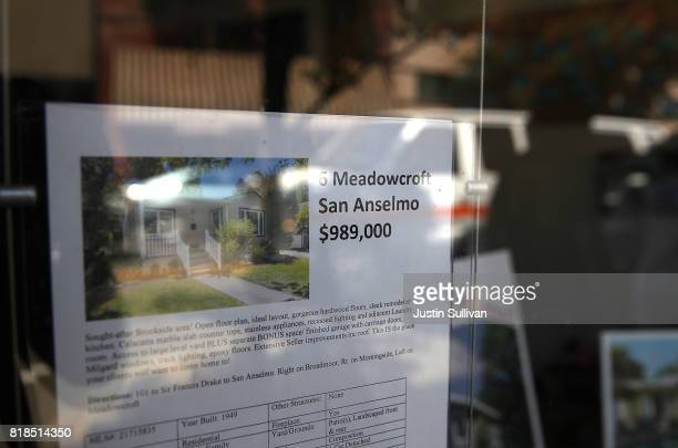 A sign advertising a home for sale is posted in the window of a real estate office on July 18 2017 in San Anselmo California California is...