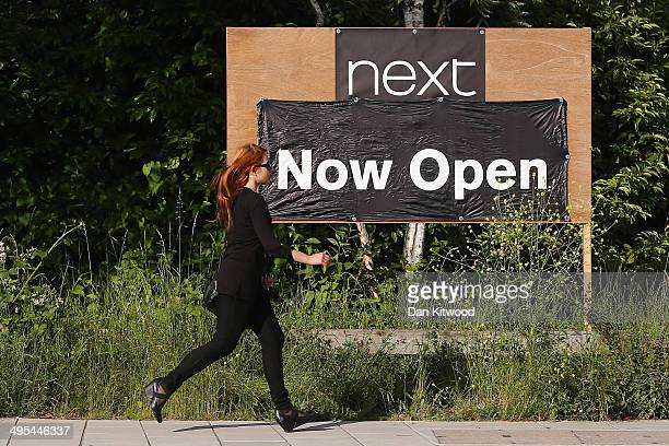 A sign advertising a new Next store in Sydenham on June 3 2014 in London England For the first time the high street retailer Next have made more...