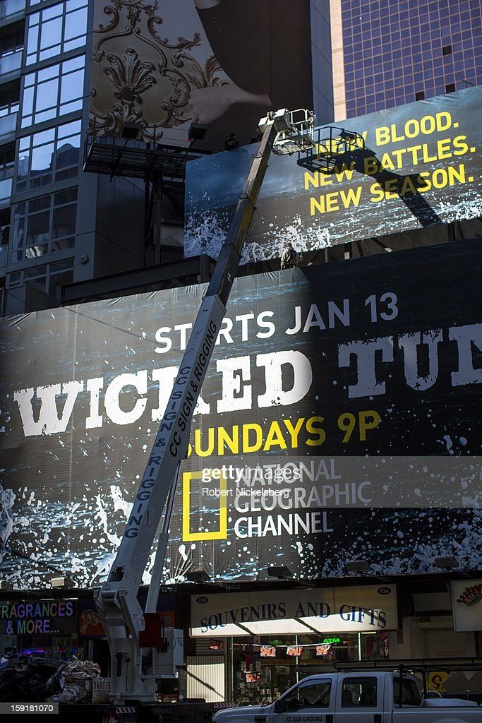 A sign advertising a new television program for the National Geographic Channel is visible on a building near Times Square January 7, 2013 in the Manhattan borough of New York.