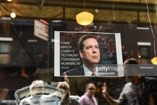 A sign advertising a watch party to see testimony from former FBI Director James Comey during a Senate Intelligence Committee hearing on Russian...
