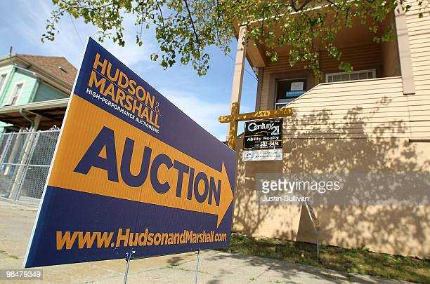 A sign advertising an auction is posted in front of a foreclosed home April 15 2010 in Oakland California Home foreclosure notices surged nearly 19...