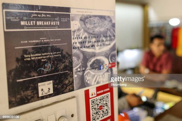 A sign advertising breakfasts made from millet is displayed on a wall atthe Vaathsalya Millet Cafe in Bengaluru India on Saturday June 10 2017...