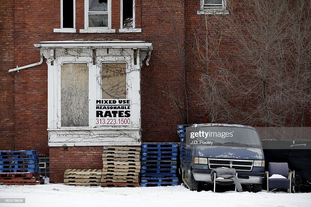 A sign advertising building rates is seen on an abandoned building on February 24, 2013 in Detroit, Michigan. The city of Detroit has faced serious economic challenges in the past decade, with a shrinking population and tax base while trying to maintain essential services. A financial review team issued a finding on February 19 identifying the city as being under a 'financial emergency.' Michigan Gov. Rick Snyder has 30 days from the report's issuance to officially declare a financial emergency, which could result in the governor appointing an emergency financial manager to oversee Detroit's municipal government.
