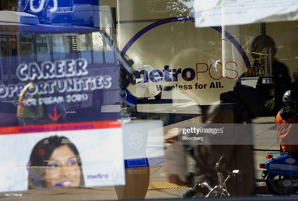 A sign advertising career opportunities is displayed as reflections of pedestrians are seen in the window of a MetroPCS Communications Inc. store in San Francisco, California, U.S., on Tuesday, Feb. 26, 2013. MetroPCS Communications Inc. fourth-quarter revenue, released today, matches estimated earnings. Photographer: David Paul Morris/Bloomberg via Getty Images