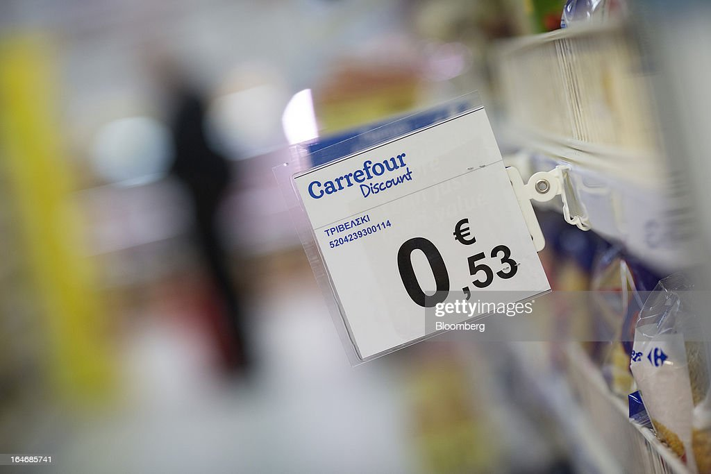 A sign advertising euro discounts hangs from a shelf in a Carrefour SA supermarket at the Mall of Cyprus in Nicosia, Cyprus, on Tuesday, March 26, 2013. Controls on capital movements to prevent money from draining out of the banking system -- allowed in exceptional circumstances under European Union law -- will remain for 'a matter of weeks,' Cypriot Finance Minister Michael Sarris said. Photographer: Simon Dawson/Bloomberg via Getty Images