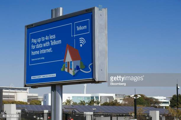 A sign advertising home internet services sits on display outside the head office of Telkom SA SOC Ltd in the Centurion district of Johannesburg...