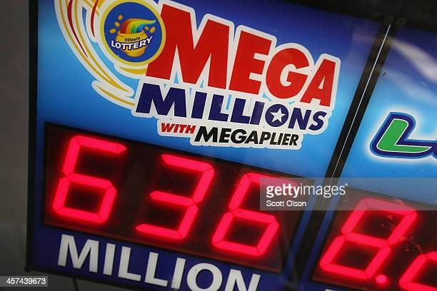 A sign advertising the $636 Million Mega Millions lottery jackpot hangs in a convenience store window on December 17 2013 in Chicago IllinoisThe...