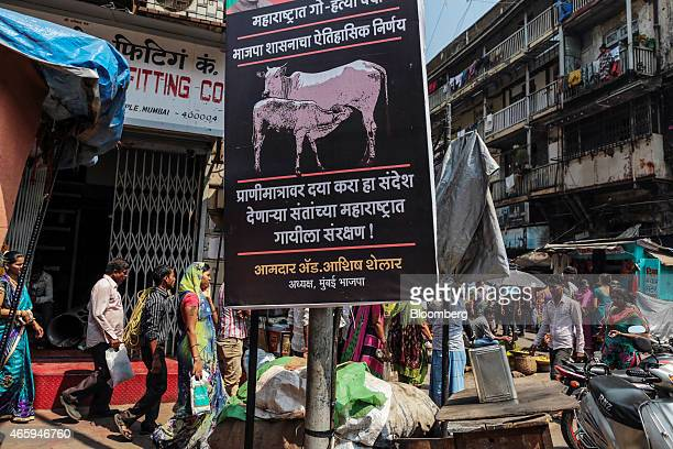 A sign advertising the ban of beef stands outside a Hindu temple in Mumbai India on Wednesday March 11 2015 The government of the state of...