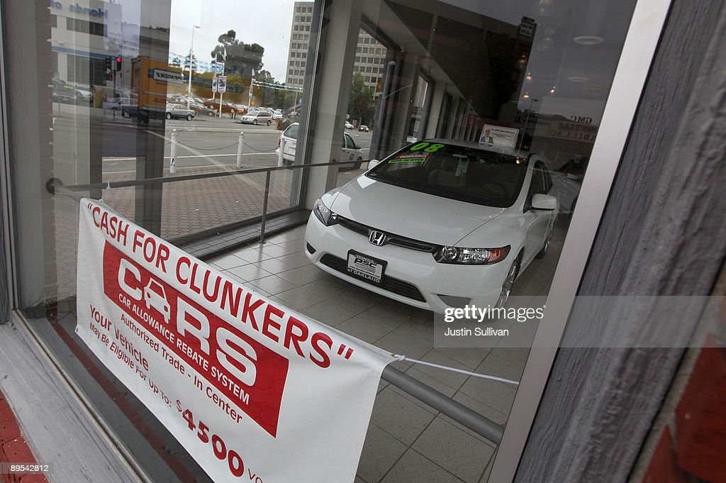 A sign advertising the 'Cash For Clunkers' program is displayed in the window at Honda of Oakland July 31, 2009 in Oakland, California. Federal lawmakers are seeking an additional $2 billion to keep the popular 'Cash For Clunkers' program going after the initial $1 billion in funding ran out after a week.