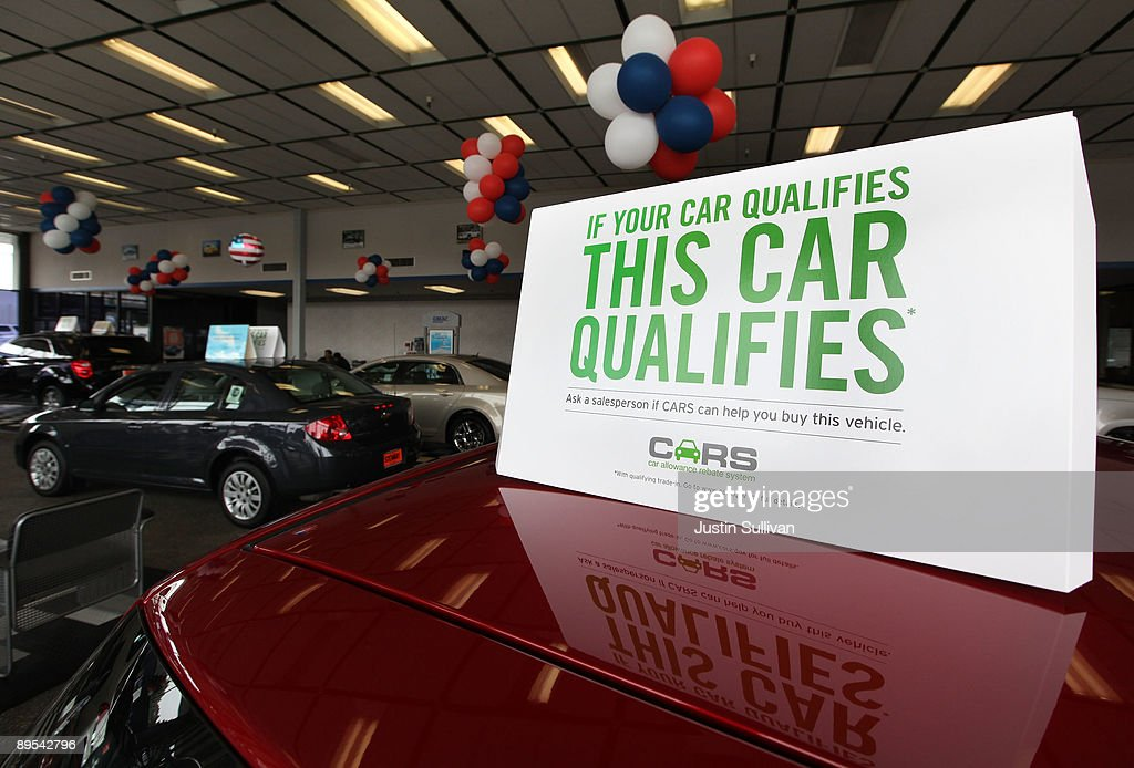 A sign advertising the 'Cash For Clunkers' program is displayed on a new car at Stewart Chevrolet July 31, 2009 in Colma, California. Federal lawmakers are seeking an additional $2 billion to keep the popular 'Cash For Clunkers' program going after the initial $1 billion in funding ran out after a week.