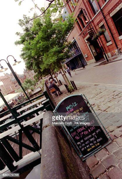A sign advertising the delights of the Metz cafebar in Canal Street Manchester a famous gay district of the city