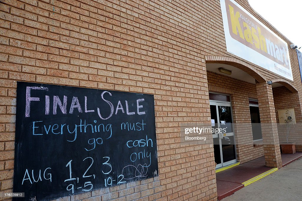 A sign advertising the final sale at KashMart pawn shop is displayed outside the now closed store in the mining town of Kalgoorlie, Australia, on Thursday, Aug. 8, 2013. Western Australia, the nation's largest state by area with 2.6 million square kilometers (1 million square miles) of land, earned A$97 billion from minerals and energy sales in 2012, down from A$108 billion in 2011, according to government figures. Photographer: Carla Gottgens/Bloomberg via Getty Images
