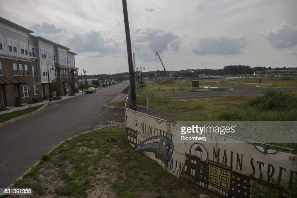 A sign advertising the Main Street North Brunswick development project is displayed in front of a construction site in North Brunswick New Jersey US...