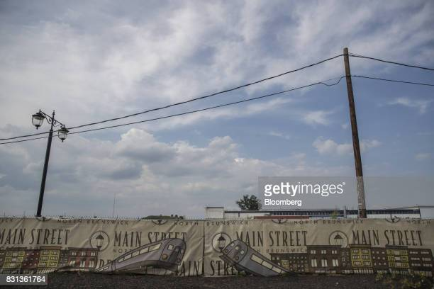 A sign advertising the Main Street North Brunswick development project hangs on display in North Brunswick New Jersey US on Thursday Aug 10 2017...