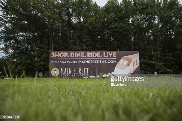 A sign advertising the Main Street North Brunswick development project reads 'Shop Dine Ride Live' in North Brunswick New Jersey US on Thursday Aug...