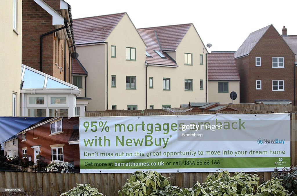 A sign advertising the re-introduction of 95% mortgages hangs on a boundary fence at a Barratt Developments Plc construction site for residential housing in Bedford, U.K., on Thursday, Dec. 13, 2012. Barratt Developments Plc, the U.K.'s largest homebuilder by volume, said advance sales rose 21 percent as government initiatives to boost homebuilding lifted private reservations in the autumn selling season. Photographer: Chris Ratcliffe/Bloomberg via Getty Images