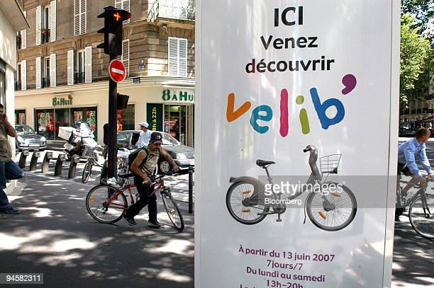 A sign advertising the Velib bicycle rental program hangs in Paris France Friday July 13 2007 Paris Mayor Bertrand Delanoe is introducing the world's...