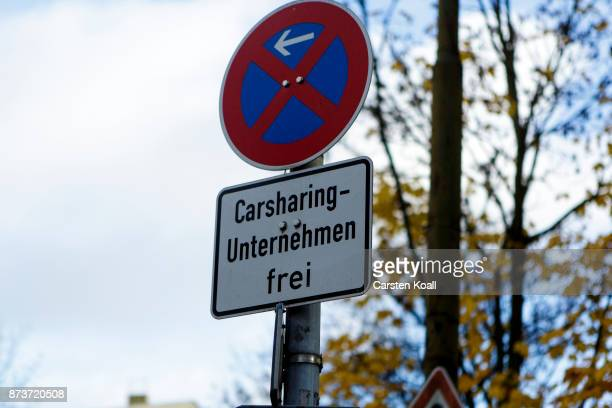 A sign advices for a place for car sharing cars on the street on November 13 2017 in Berlin Germany A number of companies have plunged into the...