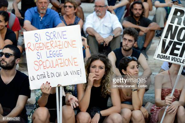 Sign against speculation on July 13 2017 in Rome Italy No one is illegal demonstration in Campidoglio against Virginia Raggi policies to say that the...