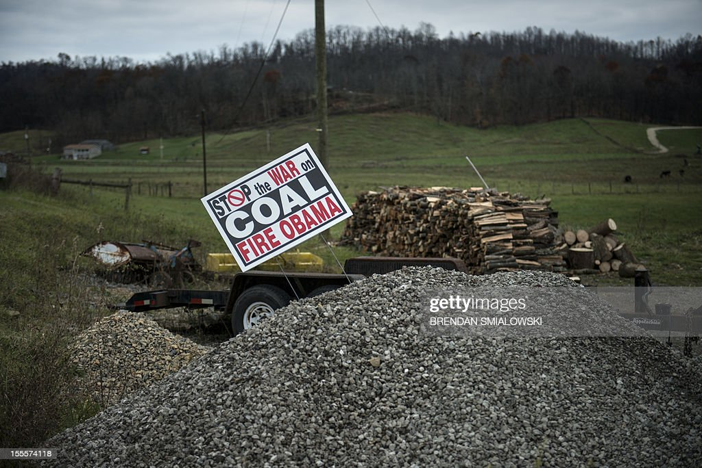 A sign against US President Barack Obama's alleged position against the coal mining industry is seen on November 5, 2012 in Quaker City, Ohio. Ohio, a battleground state which no Republican has won the US presidency without its electoral votes, is closely contested between Obama and and Republican challenger Mitt Romney. AFP PHOTO/Brendan SMIALOWSKI