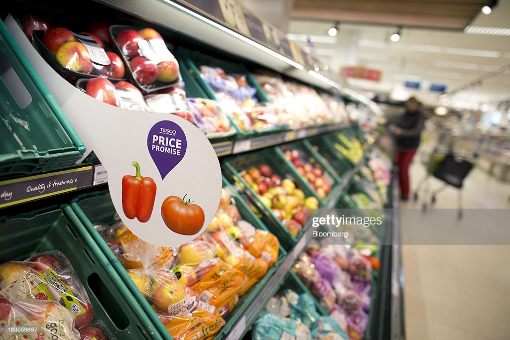 A sign alerts customers to Tesco's new 'Price Promise' initiative inside a Tesco Plc supermarket in the borough of Kensington in London, U.K., on Tuesday, March 12, 2013. Tesco Plc, the U.K.'s largest grocer launched a 'Price Promise', its latest initiative offering to match the price of customers' purchases to that of it's rivals, including Wal-Mart Stores Inc.'s ASDA. Photographer: Simon Dawson/Bloomberg via Getty Images