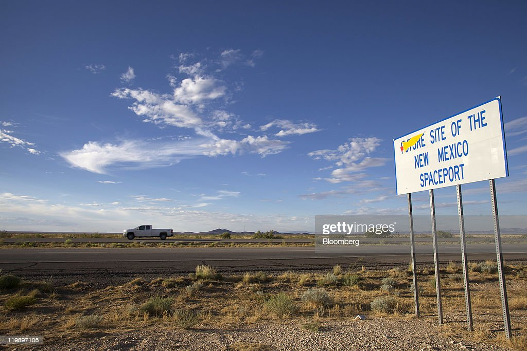 A sign along Interstate announces the site of Spaceport America several miles from the facility in Sierra County, New Mexico, U.S., on Thursday, July 14, 2011. The future home of Virgin Galactic is behind schedule and its director says it won't generate as many jobs as backers once claimed. Photographer: Christ Chavez/Bloomberg via Getty Images