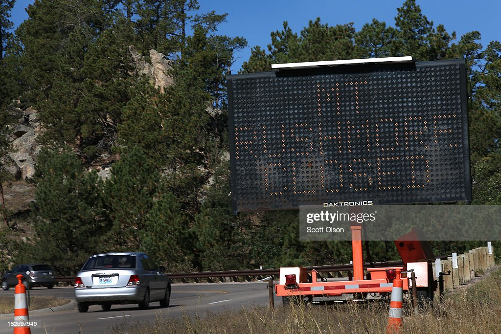 A sign along the highway near the entrance to Mount Rushmore National Memorial warns visitors that the park is closed on October 1, 2013 near Keystone, South Dakota. Mount Rushmore and all other national parks were closed today after congress failed to pass a temporary funding bill, forcing about 800,000 federal workers off the job. A bulletin issued by the Department of Interior states, 'Effective immediately upon a lapse in appropriations, the National Park Service will take all necessary steps to close and secure national park facilities and grounds in order to suspend all activities ...Day use visitors will be instructed to leave the park immediately...'