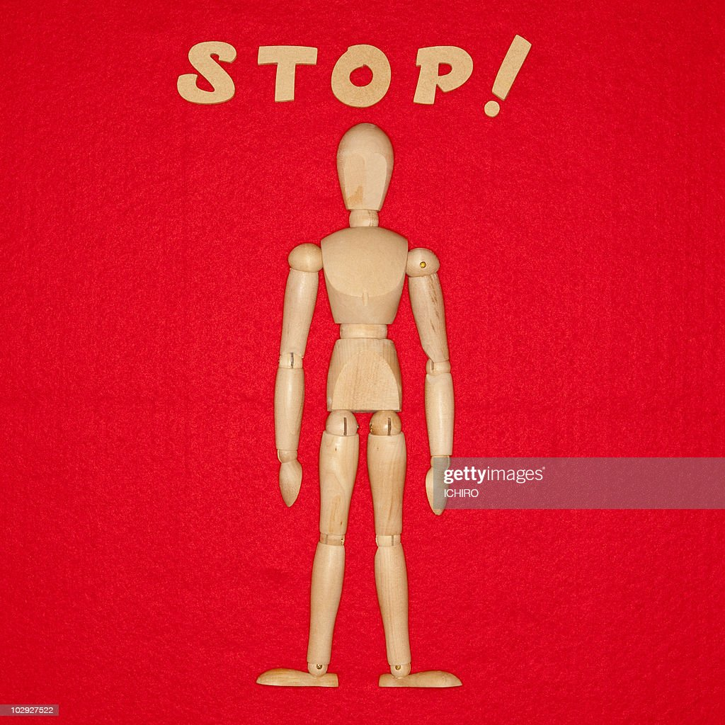 'STOP' sign and a doll. : Stock Photo