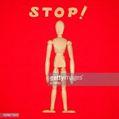 'STOP' sign and a doll. : Bildbanksbilder