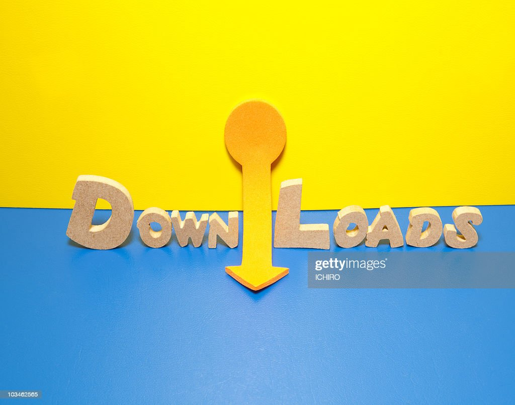 'DOWNLOADS' sign and an arrow. : Stock Photo