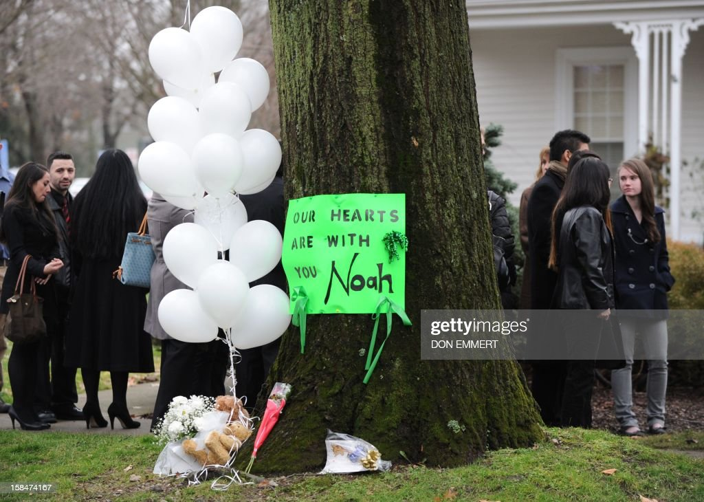 A sign and balloons outside the funeral home where services were held for six year-old Noah Pozner, who was killed in the December 14, 2012 shooting massacre in Newtown, Connecticut, at Abraham L. Green and Son Funeral Home on December 17, 2012 in Fairfield, Connecticut. Today is the first day of funerals for some of the twenty children and seven adults who were killed by 20-year-old Adam Lanza on December 14, 2012. AFP PHOTO / Don EMMERT