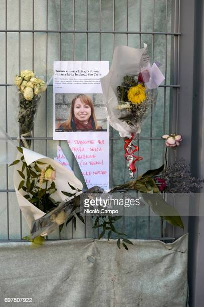 A sign and flowers in memory of Erika Pioletti who has died on June 16 from injuries sustained at the Champions League final stampede in Turins...